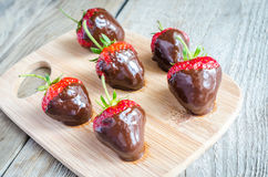 Fresh strawberries covered with dark chocolate Royalty Free Stock Image