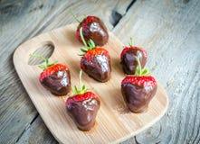 Fresh strawberries covered with dark chocolate stock photos