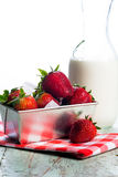 Fresh Strawberries and cream. A carton of fresh strawberries and milk or cream Stock Photography