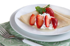 Fresh Strawberries and Cream over a Crepe Royalty Free Stock Images