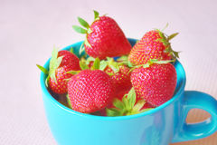 Fresh strawberries in a cup Stock Photos