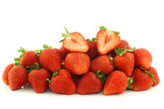 Fresh strawberries and a cut one Royalty Free Stock Images