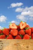 Fresh strawberries and a cut one Royalty Free Stock Image