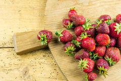Fresh strawberries on a cutting board Royalty Free Stock Photography
