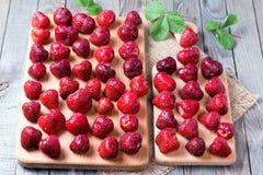 Fresh strawberries on cutting board Royalty Free Stock Photo