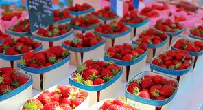 Fresh strawberries farmer market in France, Europe. Italian strawberry. Street French market at Nice. Fresh food by local farmers. Fresh vegetables and fruit Royalty Free Stock Photos