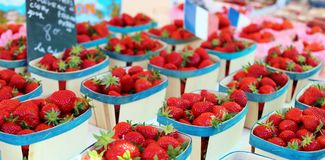 Fresh strawberries farmer market in France, Europe. Italian strawberry. Street French market at Nice. Fresh food by local farmers. Fresh vegetables and fruit Stock Photo