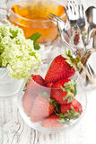 Fresh strawberries with flowers Royalty Free Stock Photos