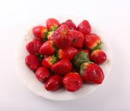 Fresh some Strawberries. Fresh strawberries fruits on white dish over white background royalty free stock images