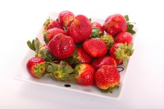 Some of fresh Strawberries. Fresh strawberries fruits on white dish royalty free stock images