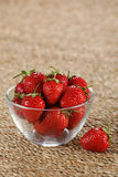 Fresh strawberries in a glass bowl Stock Image