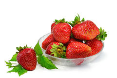 Fresh strawberries. In glass bowl, isolated on white background royalty free stock photo