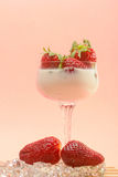 Fresh strawberries on a glass with cream Stock Photo