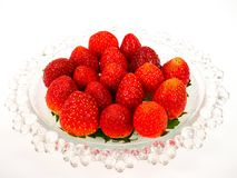 Fresh strawberries on a glass plate Stock Photos