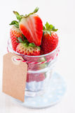 Fresh strawberries in glass with tag Stock Images