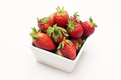 Fresh Strawberries. A group of fresh strawberries isolated on a white plate with a white background Stock Photography