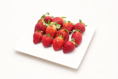 Fresh Strawberries. A group of fresh strawberries isolated on a white plate with a white background Stock Image