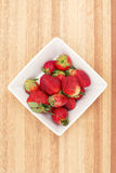 Fresh Strawberries. A group of fresh strawberries on a timber board Royalty Free Stock Images
