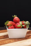 Fresh Strawberries. A group of fresh strawberries on a timber board Stock Photography
