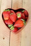 Fresh strawberries in a heart box Royalty Free Stock Photo
