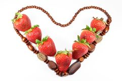 Fresh strawberries heart pattern Stock Image