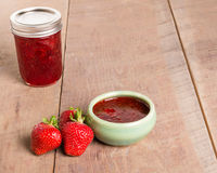 Fresh strawberries and homemade preserves Stock Images