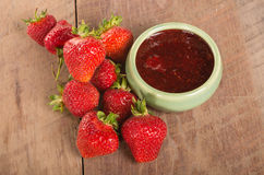 Fresh strawberries and homemade preserves Stock Photography