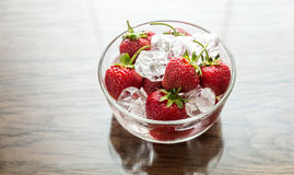 Fresh strawberries with ice cubes in the glass bowl Royalty Free Stock Photo