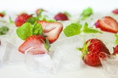 Fresh strawberries with ice cubes Royalty Free Stock Photo