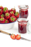 Fresh strawberries and jam jars Royalty Free Stock Image