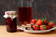 Fresh strawberries, jam, juice and chocolate Royalty Free Stock Image