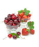 Fresh strawberries and juicy cherry isolated on a white backgrou Royalty Free Stock Images