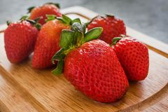Fresh strawberries juicy on wooden table. Fruit, fresas frutas frescas color red Stock Photography