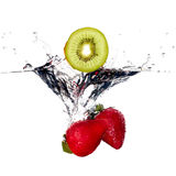 Fresh Strawberries and Kiwi Splash in Water Stock Photos
