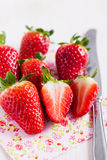 Fresh strawberries and knife Stock Photography