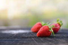 Fresh strawberries lies on oak stump, side view, copy space for the text stock photo