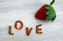 Fresh strawberries  and love inscription. Spain Stock Photo