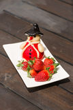 Fresh strawberries and marzipan on a rustic wooden table Royalty Free Stock Images