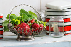 Fresh strawberries and melissa herbs Royalty Free Stock Photo