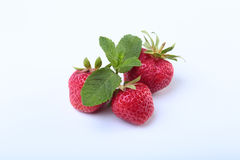 Fresh strawberries and mint leaves isolated on white background. Selective focus. Royalty Free Stock Photos