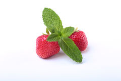Fresh strawberries and mint leaves isolated on white background. Selective focus. Royalty Free Stock Photography