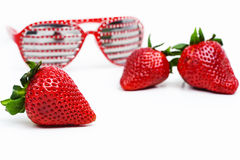 Fresh strawberries and modern red eyeglasses Royalty Free Stock Photo