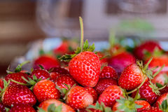 Fresh strawberries on old table wood. Stock Photos