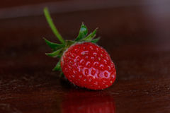 Fresh strawberries on old table wood. Royalty Free Stock Photos