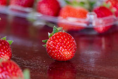 Fresh strawberries on old table wood. Stock Images