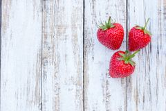 Fresh strawberries on old white wooden background. Top view with copy space. nature fruit concept and healty eating Royalty Free Stock Images