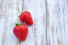 Fresh strawberries on old white wooden background. Top view with copy space. nature fruit concept and healty eating Royalty Free Stock Photos