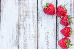 Fresh strawberries on old white wooden background. Top view with copy space. nature fruit concept and healty eating Royalty Free Stock Photography