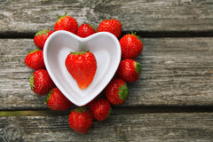 Fresh strawberries on old wooden background. Royalty Free Stock Photography