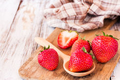 Fresh strawberries on old wooden table Stock Photo